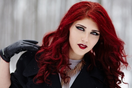 Closeup portrait of a gothic redheaded woman photo