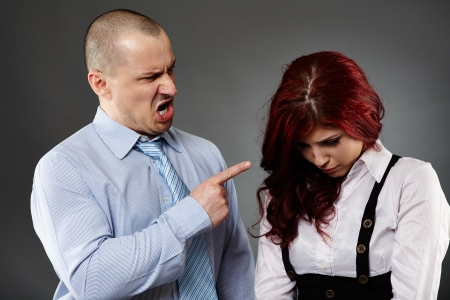 Boss angry on a new employee, shouting, threatening Stock Photo