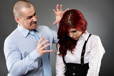 Boss angry on a new employee, shouting, threatening photo