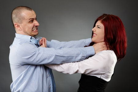 angry hand: White collar workers having a violent quarrel