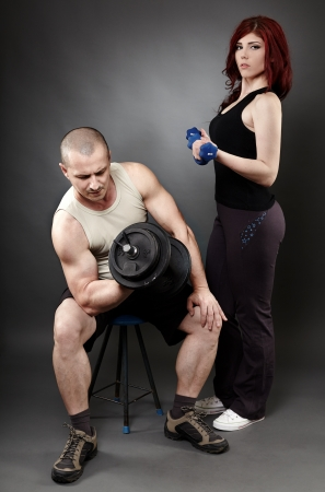 Couple working out with weights, studio shot Stock Photo - 20244917