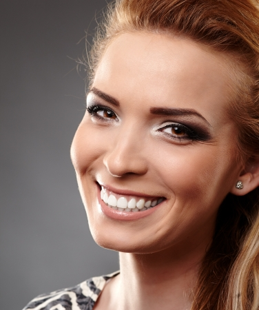 Closeup of a woman with perfect teeth smiling photo