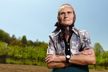 old farmer: Closeup portrait of a senior farmer woman outdoor Stock Photo