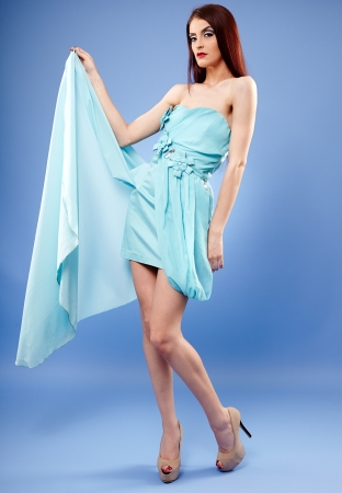 Beautiful redhead in blue dress full length portrait Stock Photo - 20245443