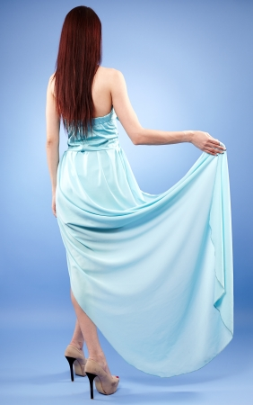 Beautiful redhead in blue dress full length portrait Stock Photo - 20245007