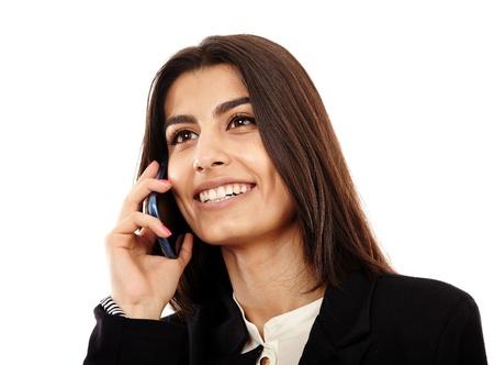 Zaken doen op mobiele telefoon - een Midden-Oosten jonge zakenvrouw spreken op mobiele telefoon Stockfoto