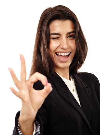 Happy young Middle Eastern businesswoman making OK sign isolated on white background photo