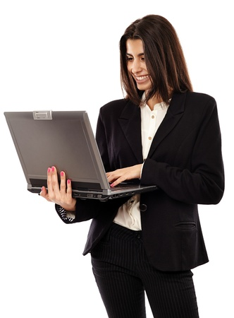 Middle Eastern business lady standing with her laptop, isolated on white background Stock Photo - 20244998