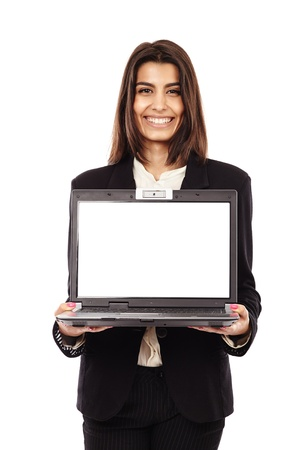 Indian businesswoman presenting a laptop with copyspace on the monitor photo