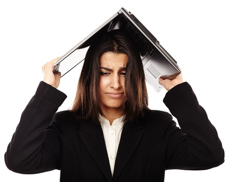 Stressed Middle Eastern business lady holding a laptop over her head Stock Photo - 20245439