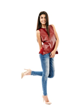 Young beautiful Middle Eastern girl with jeans and leather shirt isolated on white, full length Stock Photo - 20245442