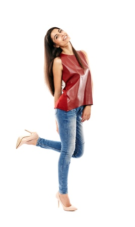Young beautiful Middle Eastern girl with jeans and leather shirt isolated on white, full length photo
