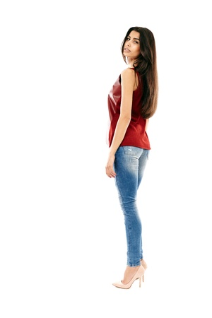 Young beautiful Middle Eastern girl with jeans and leather shirt isolated on white, full length Stock Photo - 20245434