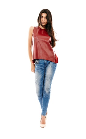 Young beautiful Middle Eastern girl with jeans and leather shirt isolated on white, full length Stock Photo - 20245445