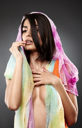 Beautiful Arab woman with a colorful veil on her, glamour closeup Stock Photo - 20340967