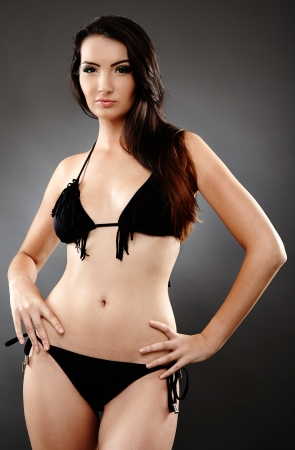 Young caucasian woman in bathing suit, studio shot Stock Photo - 20245160