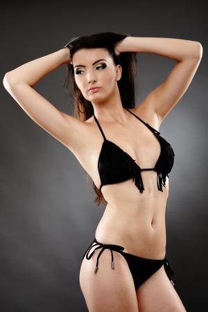 Young caucasian woman in bathing suit, studio shot Stock Photo - 20283273