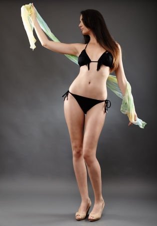 Young caucasian woman in bathing suit, studio shot photo