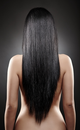 nude black women: Closeup of the back of a young caucasian woman with beautiful black hair
