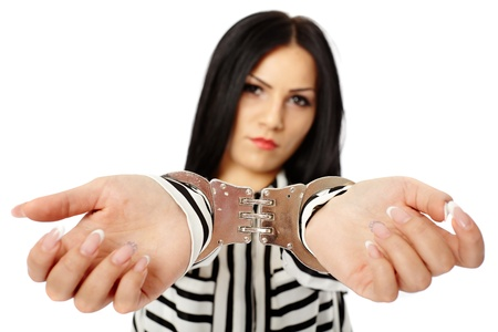 arrest women: Young businesswoman with handcuffs isolated on white background