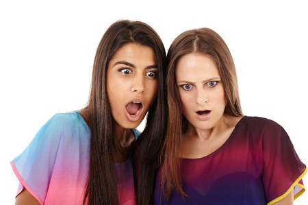 Closeup of surprised girlfriends isolated on white photo