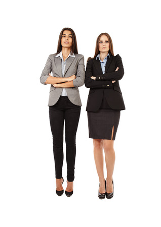 Portrait of two young successful businesswomen isolated on white background photo