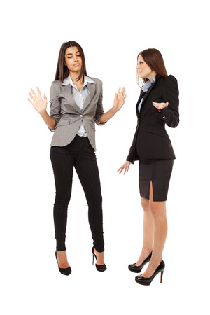 Portrait of two businesswomen having an argument isolated on white background photo