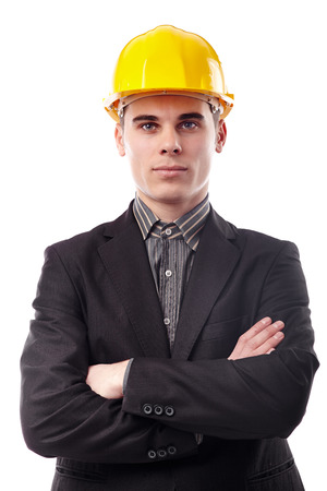 Studio shot of young engineer with arms folded wearing a helmet isolated on white photo