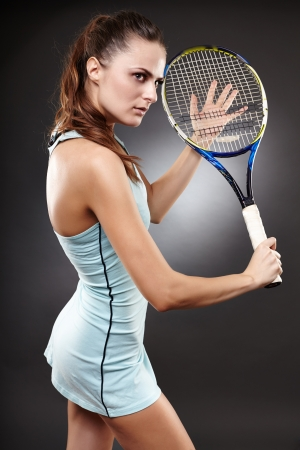 backhand: Studio shot of a female tennis player preparing to execute a backhand volley
