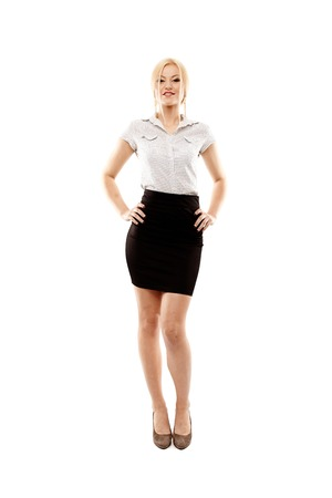 Full length studio portrait of young successful businesswoman standing akimbo, isolated over white background photo