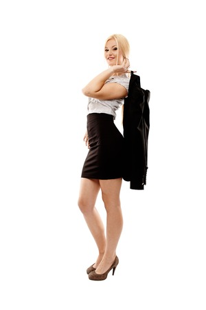 Full length studio portrait of a confident relaxed businesswoman holding her coat, isolated over white background photo