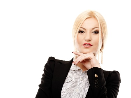 Closeup portrait of young confident businesswoman with hand on chin, isolated on white background photo