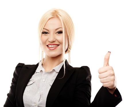 Closeup portrait of young successful businesswoman making the finger up sign, isolated on white background photo