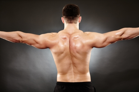 deltoids: Studio shot of bodybuilder showing his back muscles Stock Photo