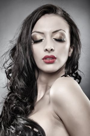 Glamorous portrait of a gorgeous middle eastern young woman with eyes closed photo