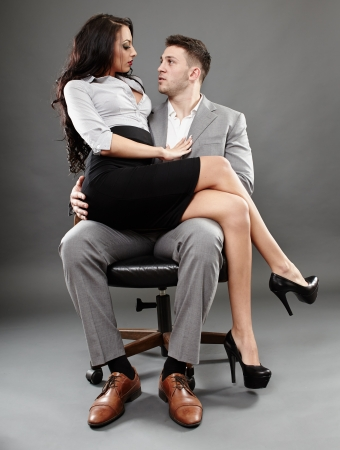 Sexy secretary sitting on the boss lap