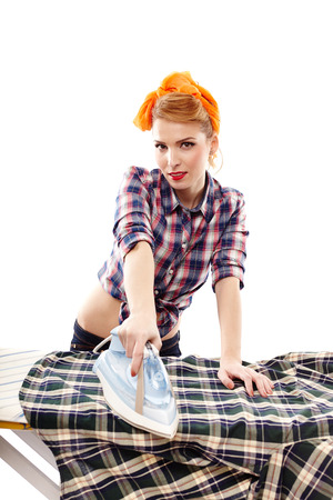 Sexy housewife ironing, isolated over white photo