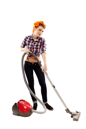 sexy housewife: sexy housewife vacuuming, isolated over white background
