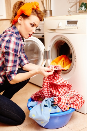 housewife spotting a stain on the laundry Standard-Bild