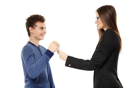 Studio shot of positive teacher giving the happy student the test paper results, isolated over white background Stock Photo - 24960667
