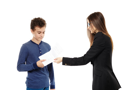 Studio shot of  teacher giving the student the test paper results, isolated over white background Stock Photo - 24960668
