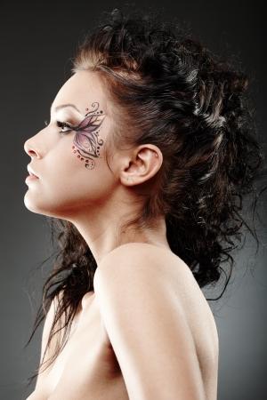 Closeup portrait of a beautiful woman with fantasy makeup  photo