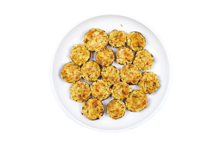 Stuffed mushrooms on a plate isolated on white background photo