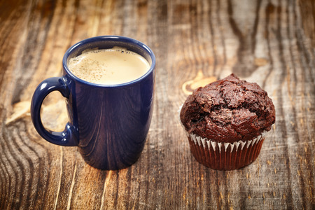Delicious breakfast - a chocolate muffin and a big cup of cappuccino photo