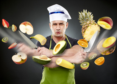 Realistic conceptual image of a chef slicing many vegetables in mid-air, with motion blur photo