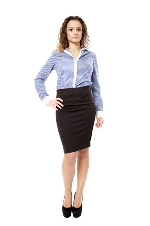 Full length portrait of a confident businesswoman with hand on hip, isolated over white background photo