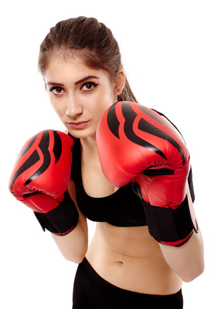 Young caucasian woman boxer with gloves isolated on white background photo