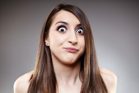 Closeup of a woman with an expression of shock on her face photo