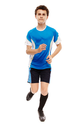 Full length of a teenage soccer player running towards the camera, isolated on white background