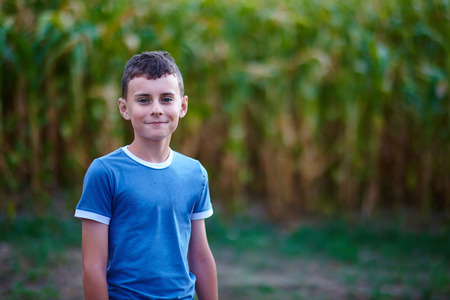 ��beautiful boy�: Closeup of a beautiful boy outdoor in the countryside with selective focus